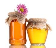 Zoete honing in kruiken Stock Foto's