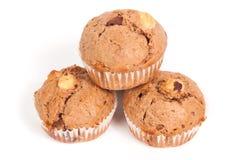 Zoete muffins op wit Stock Fotografie