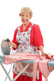 Zoete Oude Dame Ironing stock foto's