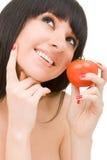 Zoete vrouw met tomaat Royalty-vrije Stock Foto's
