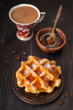 Zoete wafels, honing en espresso Stock Foto