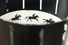 A zoetrope is film animation devices that produce the illusion of motion by displaying motion of drawings. Illustrative photo. A zoetrope is one of several pre stock photos