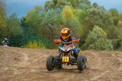 Zolin Nikita 11. SERPUKHOV, RUSSIA - OCTOBER 7, 2017: Zolin Nikita 11,  Class ATV-JUNIORS, in the 4 stage  MX series, the Red Wings Cup 2017 super country-cross Stock Image