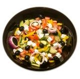 Zolla di insalata greca nel nero Fotografie Stock