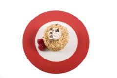 Zolla rossa con la torta della nocciola. Fotografia Stock