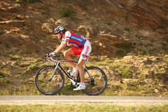 Zolt Der cyclist from Serbia riding uphill to Paltinis. Paltinis, Sibiu, Romania - 5 July 2012: Sibiu Cycling Tour 2012 - Stage I. Cyclists climbing the montains Stock Image