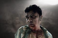 Zombi assustador na sala escura Imagens de Stock Royalty Free