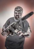 Zombi con la sierra mecánica Imagen de archivo libre de regalías