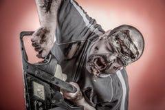 Zombi con la sierra mecánica Foto de archivo libre de regalías
