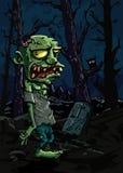 Zombi de dessin animé dans un cimetière Photo libre de droits
