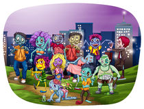 Zombi. Group of zombies gathering with city buildings on the background Stock Photos