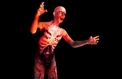 Zombie 123. A image of a zombie with a black background Royalty Free Stock Photography