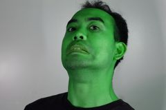 Zombie. Guy in green makeup looking Zombie-like Royalty Free Stock Image