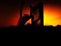 Zombie 93. A zombie emerging from the ground with a atmospheric background Stock Photo