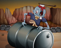 A zombie above the barrel Royalty Free Stock Images