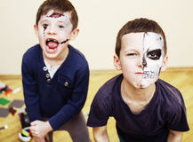 Zombie apocalypse kids concept. Birthday party celebration facep. Aint on children dead bride, scar face,  skeleton together having fun Royalty Free Stock Image