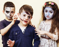 Zombie apocalypse kids concept. Birthday party celebration facep. Aint on children dead bride, scar face, skeleton together, halloween holiday Royalty Free Stock Photo