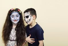 Zombie apocalypse kids concept. Birthday party celebration facep. Aint on children dead bride, scar face, skeleton together having fun Stock Photography
