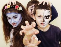 Zombie apocalypse kids concept. Birthday party celebration facep. Aint on children dead bride, scar face, skeleton together having fun royalty free stock photo