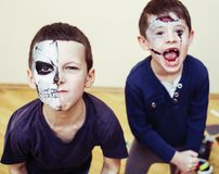 Zombie apocalypse kids concept. Birthday party celebration facep. Aint on children dead bride, scar face, skeleton together, halloween holiday stock photo