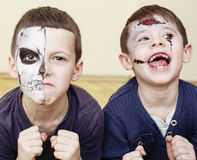 Zombie apocalypse kids concept. Birthday party celebration facepaint on children dead bride, scar face, skeleton. Together, halloween holiday Royalty Free Stock Photos