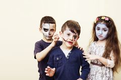 Zombie apocalypse kids concept. Birthday party celebration facep. Aint on children dead bride, scar face, skeleton together having fun Stock Photos