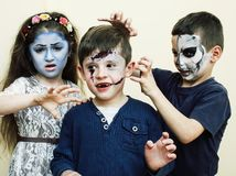 Zombie apocalypse kids concept. Birthday party celebration facep. Aint on children dead bride, scar face, skeleton together having fun royalty free stock photos