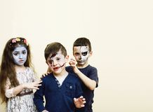 Zombie apocalypse kids concept. Birthday party celebration facep. Aint on children dead bride, scar face, skeleton together having fun stock image