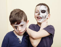 Zombie apocalypse kids concept. Birthday party celebration facepaint on children dead bride, scar face, skeleton Stock Photos