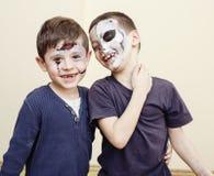 Zombie apocalypse kids concept. Birthday party celebration facepaint on children dead bride, scar face, skeleton. Together having fun stock photo