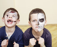 Zombie apocalypse kids concept. Birthday party celebration facepaint on children dead bride, scar face, zombi skeleton Royalty Free Stock Photography