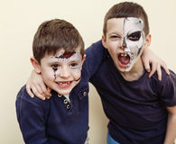 Zombie apocalypse kids concept. Birthday party celebration facepaint on children dead bride, scar face, zombi skeleton Stock Photography