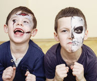 Zombie apocalypse kids concept. Halloween party celebration facepaint on children dead bride, scar face, skeleton. Together close up Stock Image
