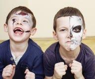 Zombie apocalypse kids concept. Halloween party celebration facepaint on children dead bride, scar face, skeleton. Together close up stock image