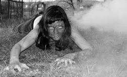 Zombie attack. Horror posing at old cemetery Royalty Free Stock Photography