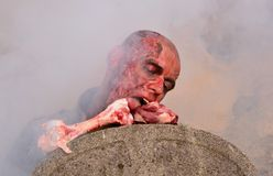 Zombie attack. Horror posing at old cemetery Royalty Free Stock Photo
