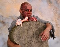 Zombie attack. Horror posing at old cemetery Royalty Free Stock Images