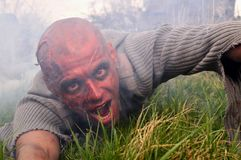 Zombie attack. Horror posing at old cemetery Stock Photo