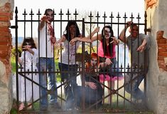 Zombie attack. Horror posing at old cemetery Stock Photos