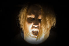 Zombie Attack. A photo of a zombie with bright yellow zombie eyes Royalty Free Stock Photography