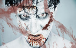 Zombie behind a bloody glass Stock Photo