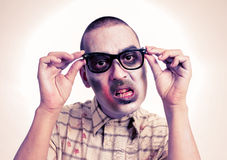Zombie with black plastic-rimmed eyeglasses Stock Images