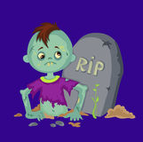 Zombie boy coming from a gravestone. Stock Image