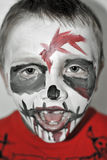 Zombie boy. Halloween party, boy with zombie painted face royalty free stock images