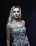 Zombie bride. Portrait of beautiful zombie bride looked scary and standing at dark background. shot in studio Stock Image