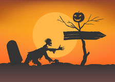 Zombie climbs from tomb towards the pointer. Zombie climbs from tomb towards the pointer and dead tree with smiling pumpkin. Moon background. Halloween template Royalty Free Stock Images
