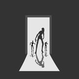 Zombie comes into the house through the open door. Zombie silhouette comes into the house through the open door. Shadows in dark room. Halloween theme background Stock Photo