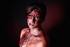 Zombie. Dangerous Alive Zomby. Professional make up for horror film (makeup faceart bodyart aqua grim) cosmetics. Realistic photo. Can be used for Halloween Royalty Free Stock Photos