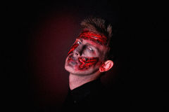 Zombie. Dangerous Alive Zomby. Professional make up for horror film (makeup faceart bodyart aqua grim) cosmetics. Realistic photo. Can be used for Halloween Stock Images