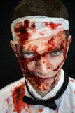Zombie. Dangerous Alive Zomby. Professional make up for new horror film (makeup faceart bodyart aqua grim), cosmetics. Realistic photo. Can be used for Halloween Royalty Free Stock Photos